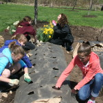 Marion Mass's daughter and friends, planting potatoes